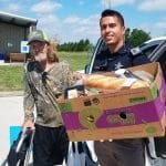 Sheriff Deputy Acosta assists food pantry client