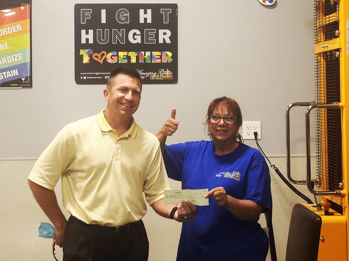 Adam Legget with State Farm donates to Amazing Grace Food Pantry