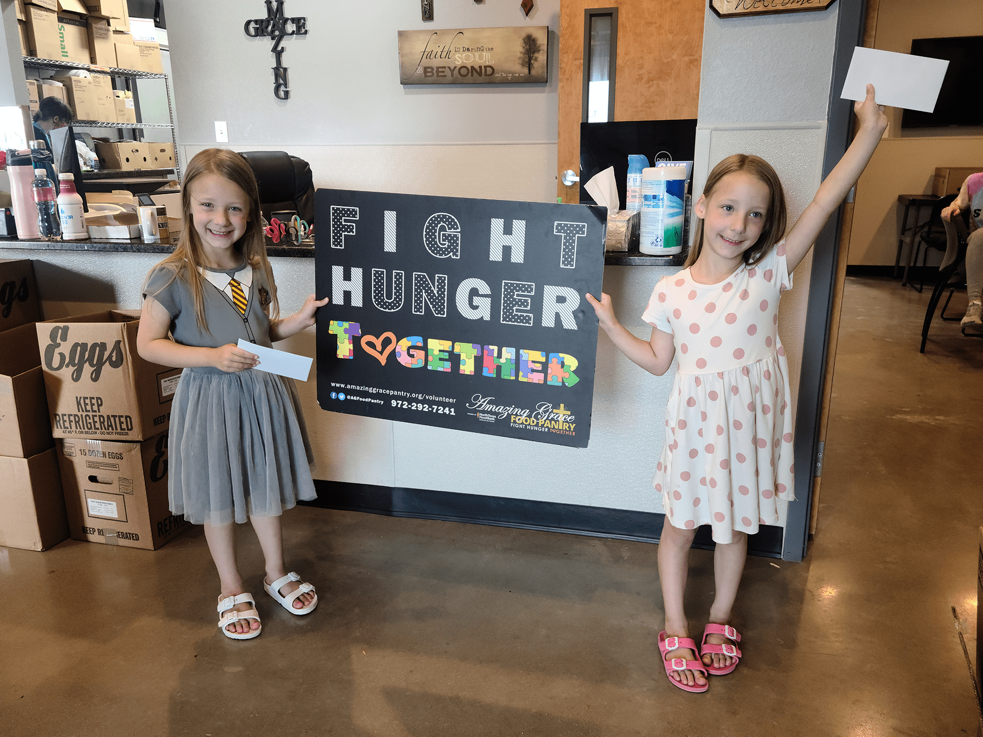 Kenna and Kaylee selected Amazing Grace Food Pantry to make a huge donation